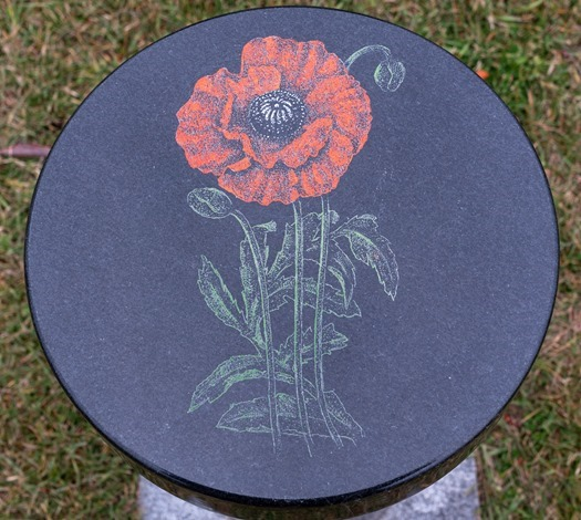 A Poppy engraved on a memorial for those who gave their lives that we should remain free